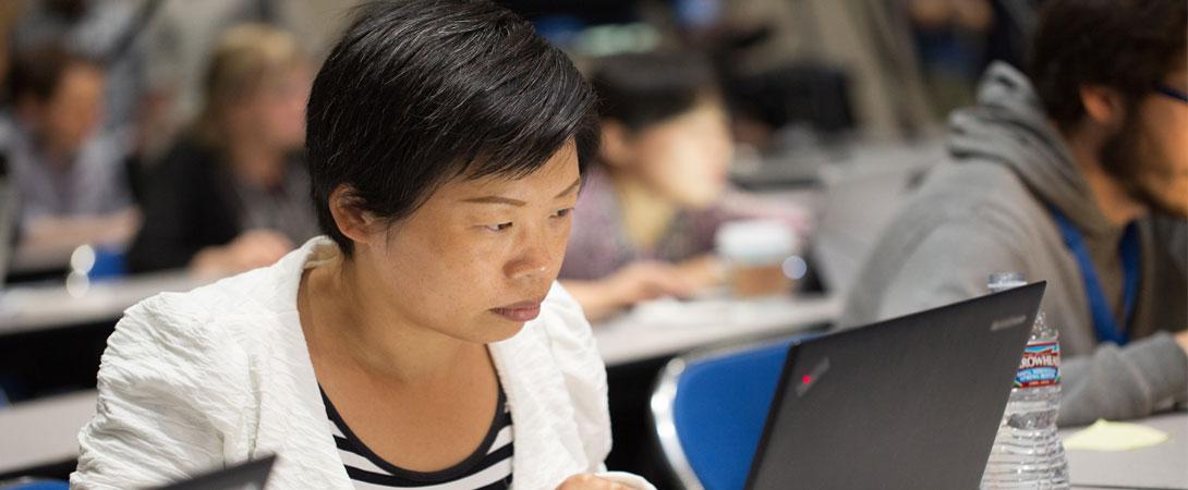 Neuroscientist works on computer