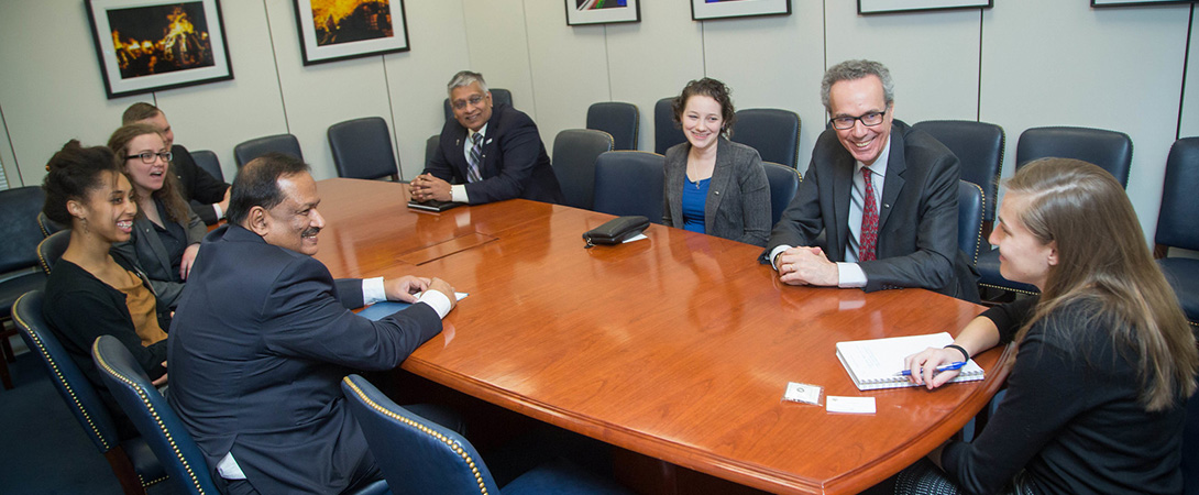 Photo of eight people sitting around a table advocating for neuroscience during SfN's Capitol Hill Day 2017