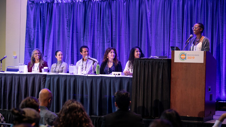Six Panelists sit at a table for a Neuroscience 2019 Professional Development Workshop.