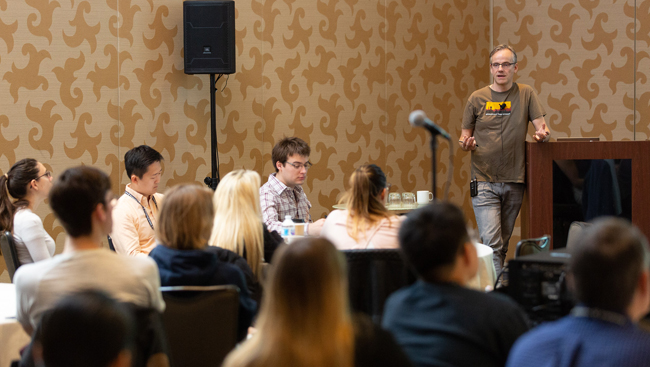 Hynek Wichterle talks at a Meet-the-Expert session during Neuroscience 2018 while a crowd listens intently.