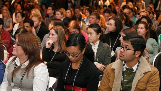 A diverse group of neuroscientists attend a seminar.